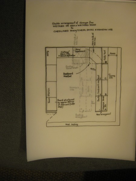 The plan compares proposed baseboard arrangements (bold lines to existing(broken feint )